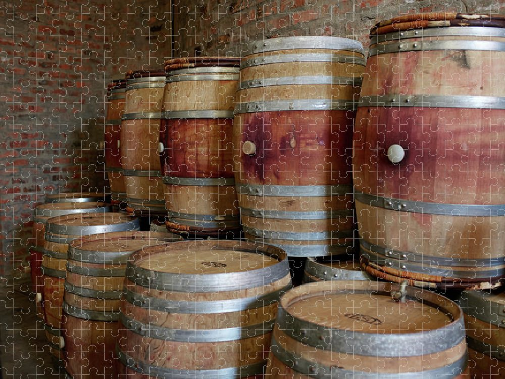 Stellenbosch Puzzle featuring the photograph Pile Of Wooden Barrels At Winery by Klaus Vedfelt