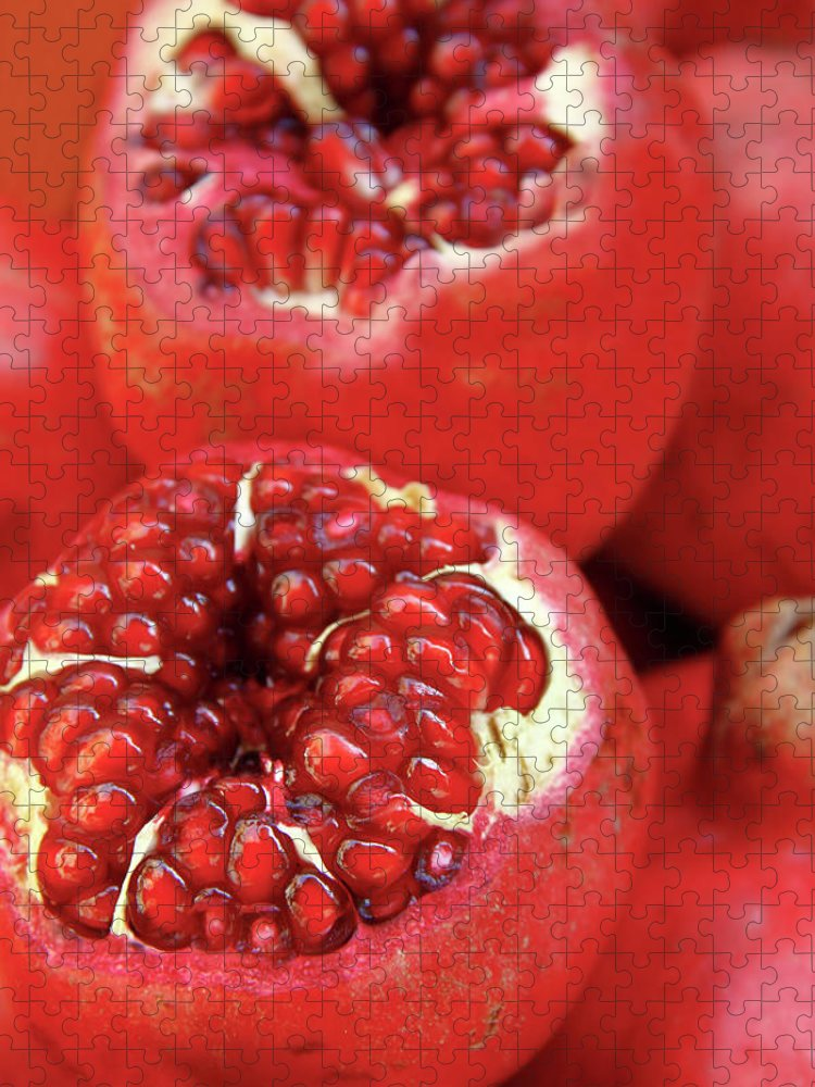 Fermenting Puzzle featuring the photograph Pomegranates by Oonal