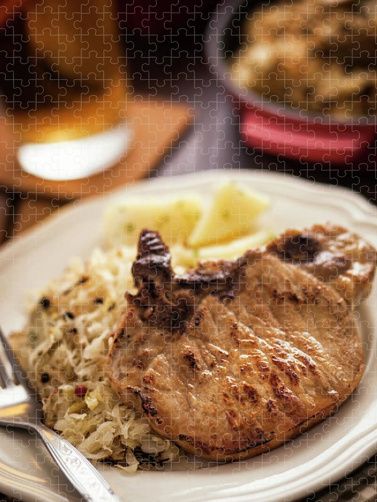 Meat Chop Puzzle featuring the photograph Pork Chop And Sauerkraut by Gmvozd