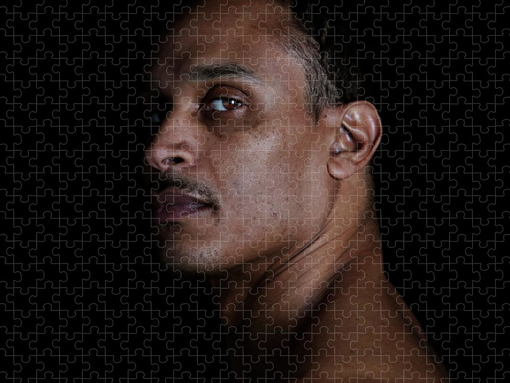 People Puzzle featuring the photograph Portrait Of A Man On A Black Background by Michael Duva
