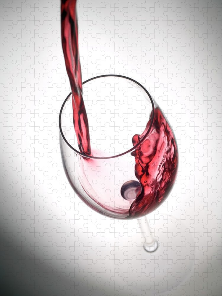 Alcohol Puzzle featuring the photograph Pouring Red Wine Into A Glass by Stockcam