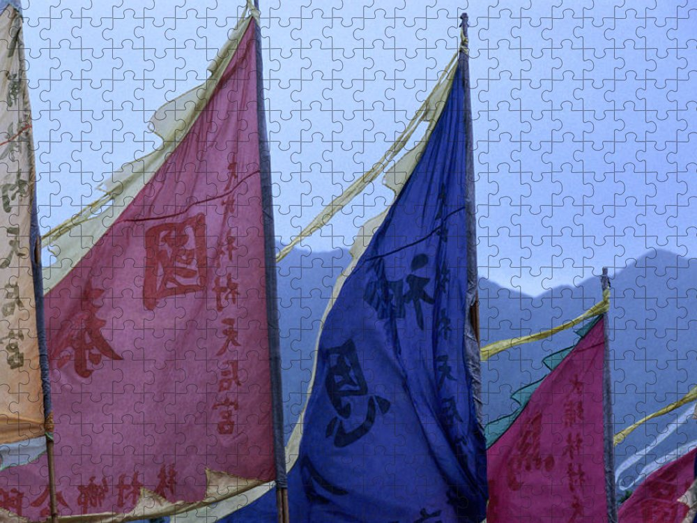 Chinese Culture Puzzle featuring the photograph Prayer Flags To The Sea Goddess Blow In by Lonely Planet