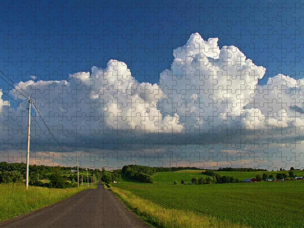 Tranquility Puzzle featuring the photograph Puffysummer Clouds And Country Farm Road by Matt Champlin