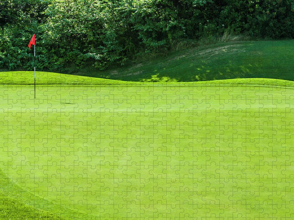 The End Puzzle featuring the photograph Putting Green And Flag At A Golf Course by Stuart Dee