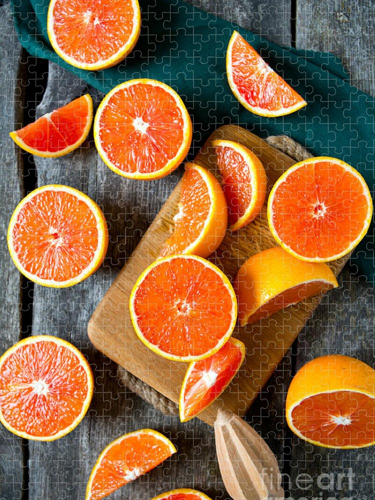 Country Puzzle featuring the photograph Red Oranges On Wooden Surface by Diana Taliun
