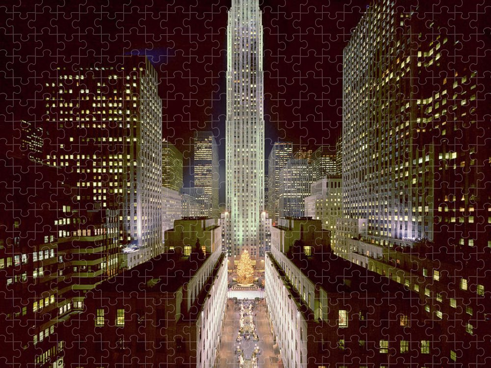 1980-1989 Puzzle featuring the photograph Rockefeller Center, Manhatten, At by Thorney Lieberman