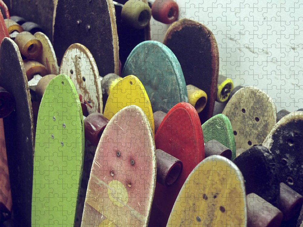 Recreational Pursuit Puzzle featuring the photograph Rows Of Used Skateboards Leaning by Fstop Images - Brian Caissie