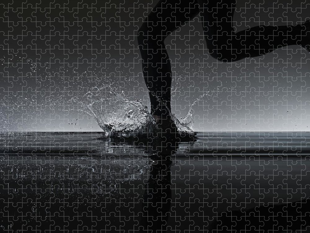 Recreational Pursuit Puzzle featuring the photograph Running Through Water by Jonathan Knowles