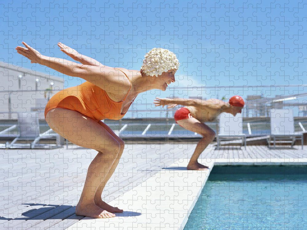 Diving Into Water Puzzle featuring the photograph Senior Couple Ready To Dive In To by Stockbyte