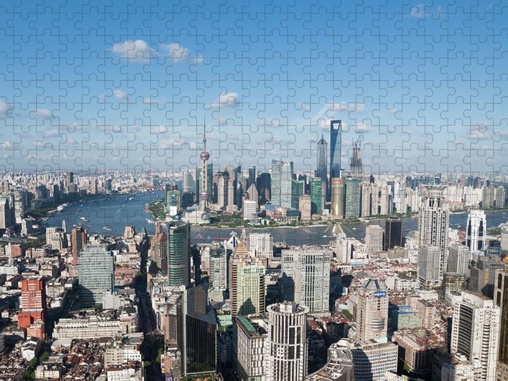 Tranquility Puzzle featuring the photograph Shanghai Skyline Across The Huangpu by Hugociss