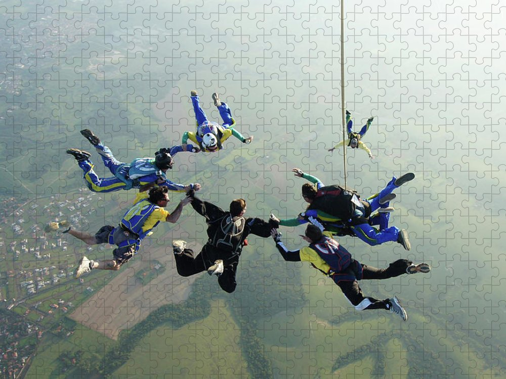 Parachuting Puzzle featuring the photograph Skydiving Tandem Formation Group by Graiki