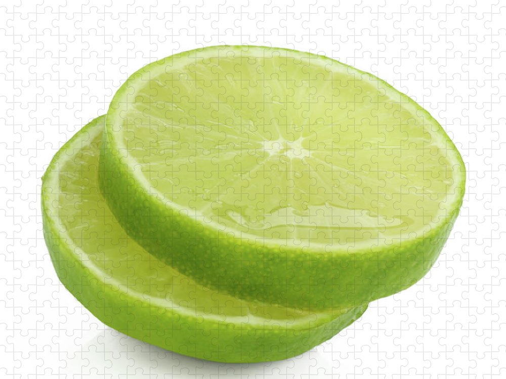 White Background Puzzle featuring the photograph Slices Of Fresh, Juicy, Freshly Cut Lime by Rosemary Calvert