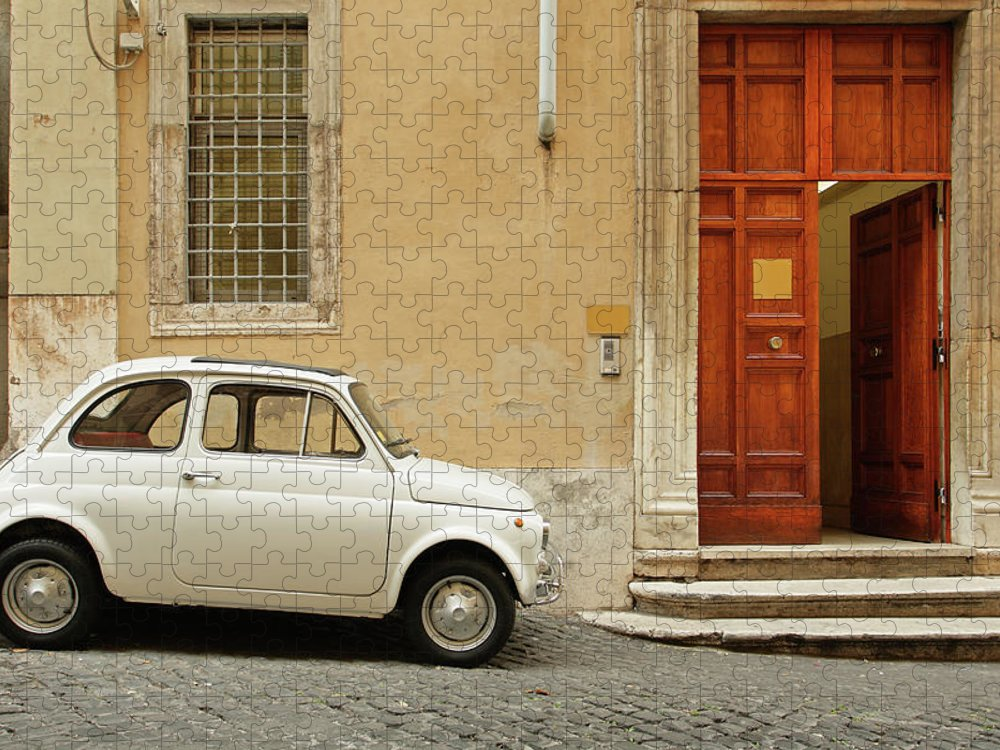 Steps Puzzle featuring the photograph Small Coupe Parked Near A Doorway On A by S. Greg Panosian