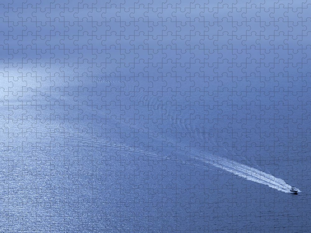 Scenics Puzzle featuring the photograph Speedboat On The Sea by Nikada
