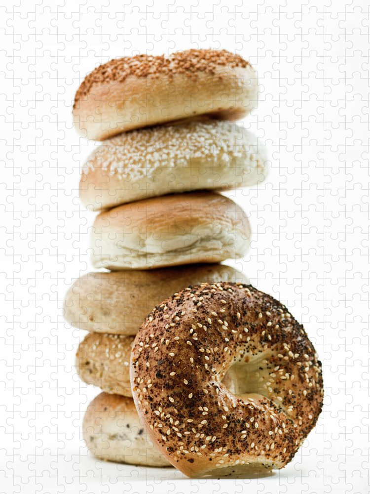 Breakfast Puzzle featuring the photograph Stack Of Assorted Bagels by Juanmonino