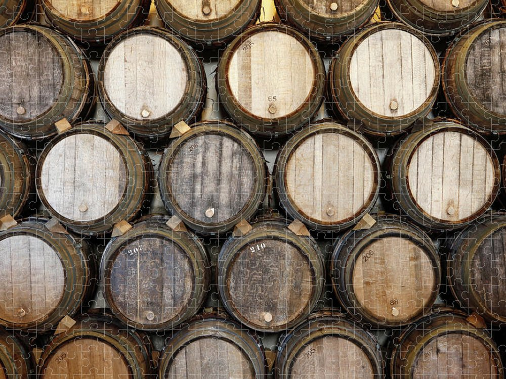 Alcohol Puzzle featuring the photograph Stacked Oak Barrels In A Winery by Marc Volk