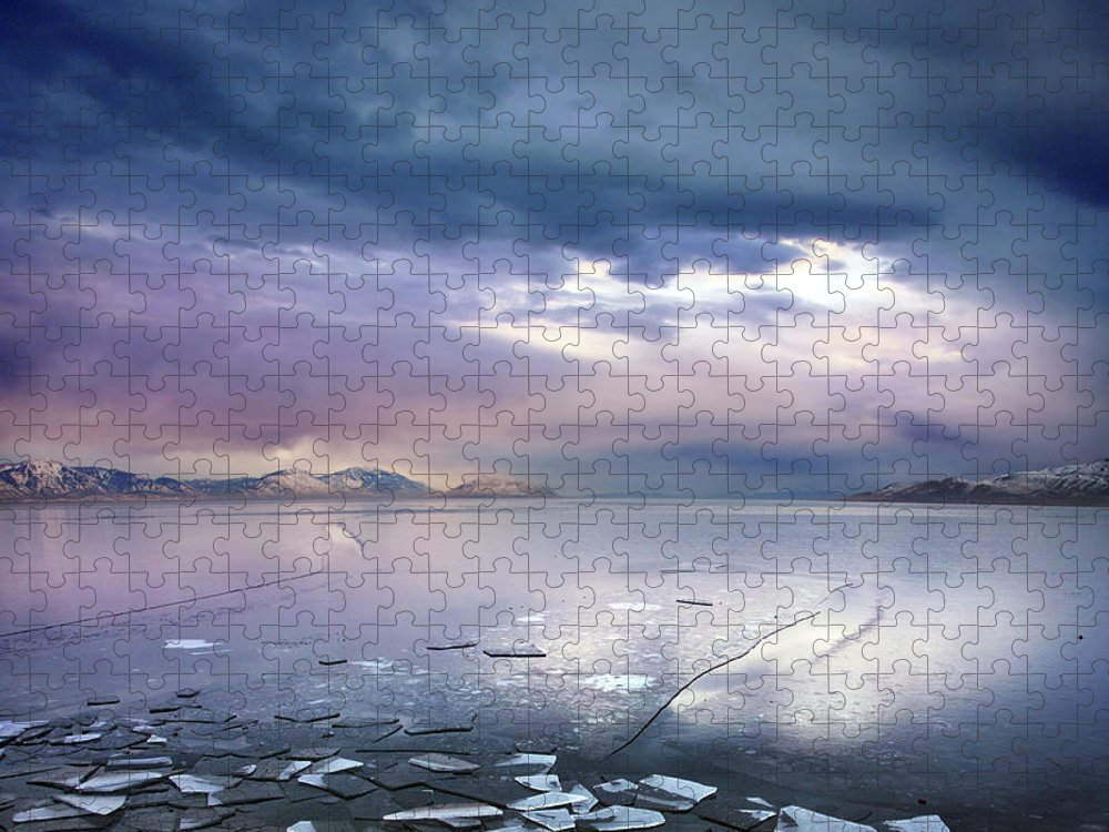 Scenics Puzzle featuring the photograph Storm Clouds Clearing Over Icy Lake by Utah-based Photographer Ryan Houston