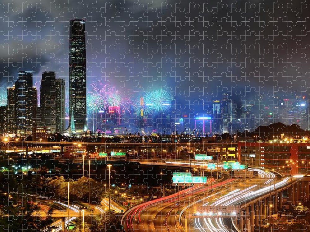 Firework Display Puzzle featuring the photograph Street Light Crosses Firework by Eddymtl