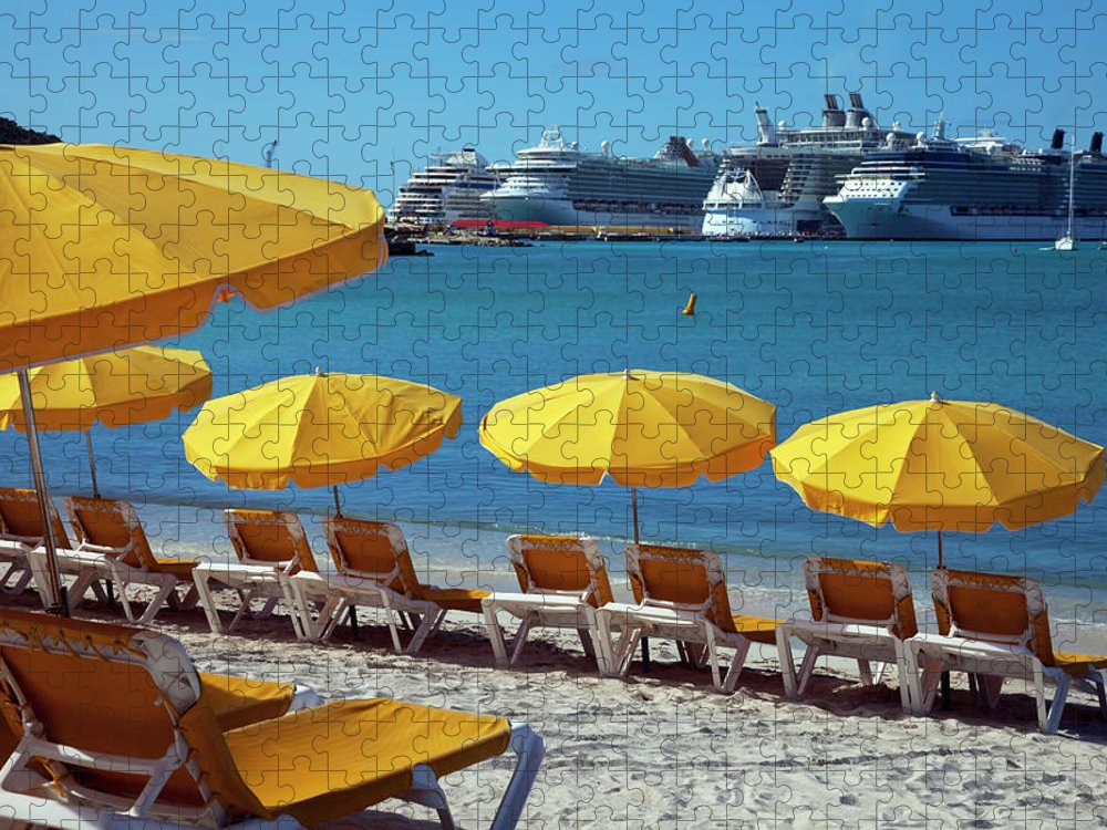 In A Row Puzzle featuring the photograph Sun Loungers And Sunshades On The Beach by Onfilm