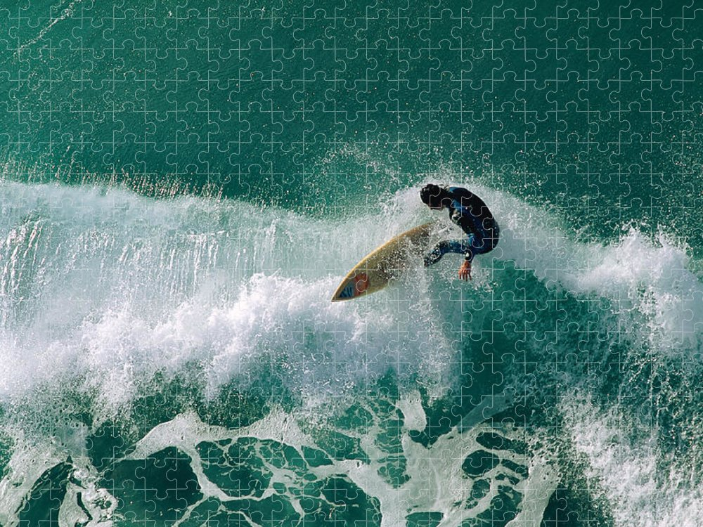 Tide Puzzle featuring the photograph Surfer Riding Wave by Stockbyte