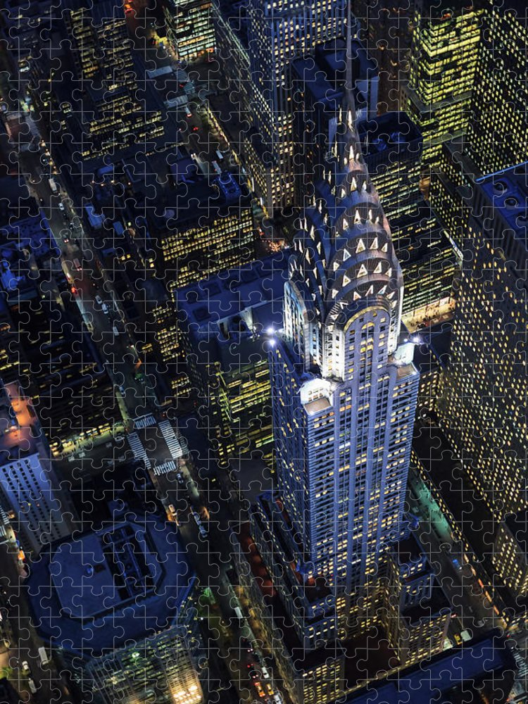 Downtown District Puzzle featuring the photograph The Chrysler Building And Manhattan by Berthold Trenkel