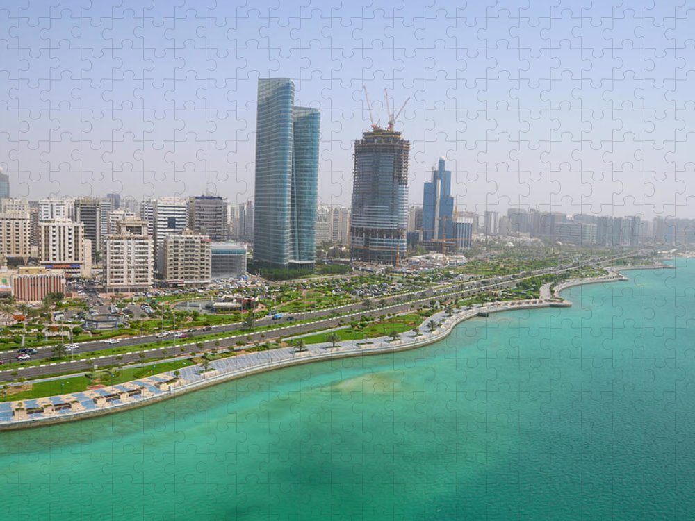 Man Made Puzzle featuring the photograph The Seaside City Of Corniche Abu Dhabi by Deveritt
