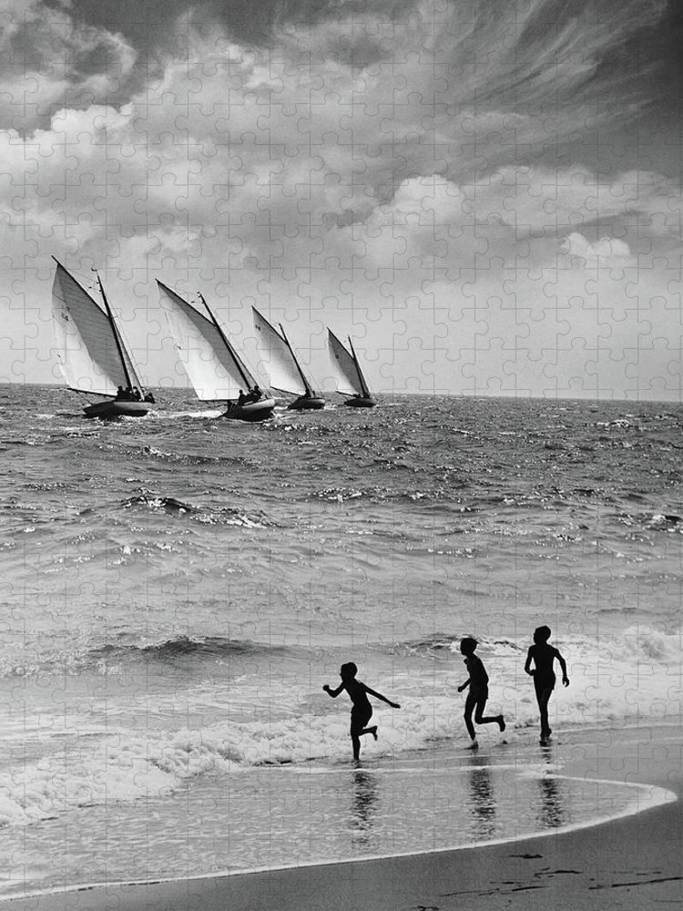 Following Puzzle featuring the photograph Three Boys Running Along Beach by Stockbyte