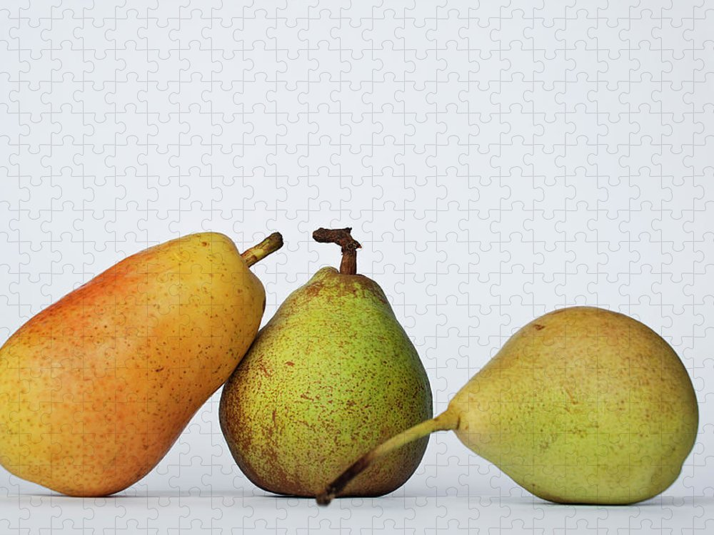 Healthy Eating Puzzle featuring the photograph Three Diferent Pears Isolated On Grey by Irantzu Arbaizagoitia Photography