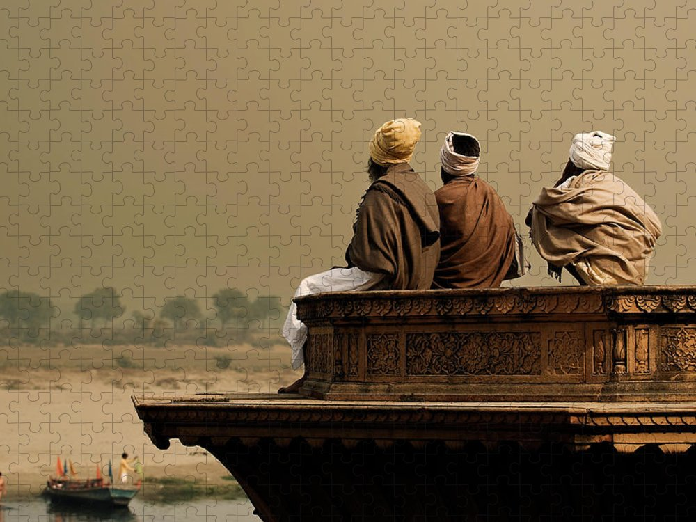 Water's Edge Puzzle featuring the photograph Three Sadhus Meditating By The Yamuna by Globalstock