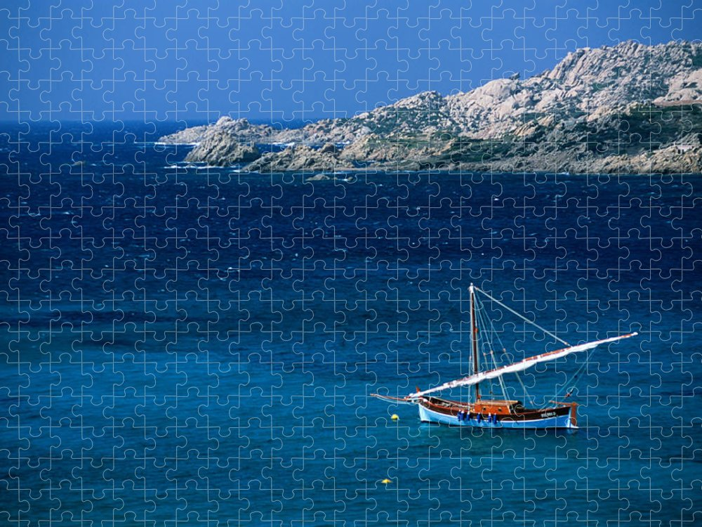 Sailboat Puzzle featuring the photograph Traditional Sailboat On Rocky Coast Of by Dallas Stribley