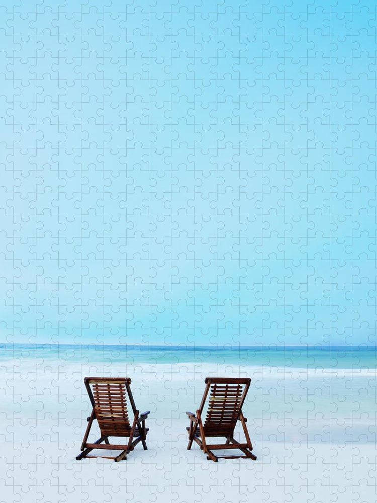 Dawn Puzzle featuring the photograph Two Beach Chairs On Tropical Beach At by Thomas Barwick