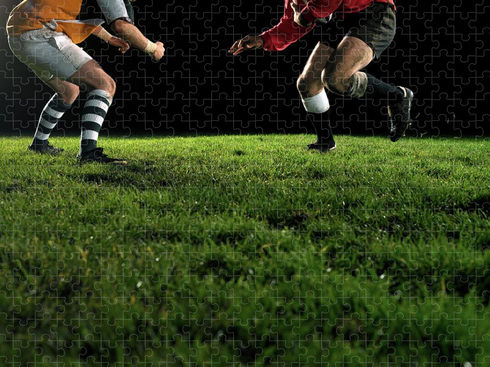 Grass Puzzle featuring the photograph Two Opposing Rugby Players, One Holding by Thomas Barwick