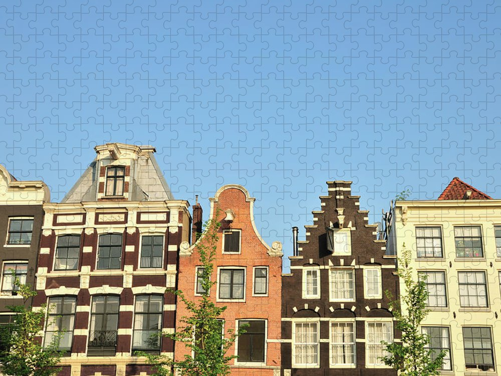 In A Row Puzzle featuring the photograph Typical Canal Houses, Amsterdam, The by Gorazdbertalanic