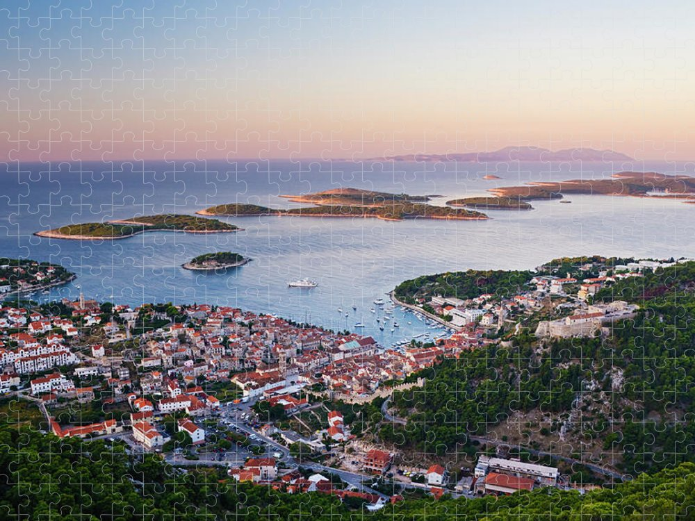 Scenics Puzzle featuring the photograph View Of Hvar Town At Dawn by Jeremy Woodhouse