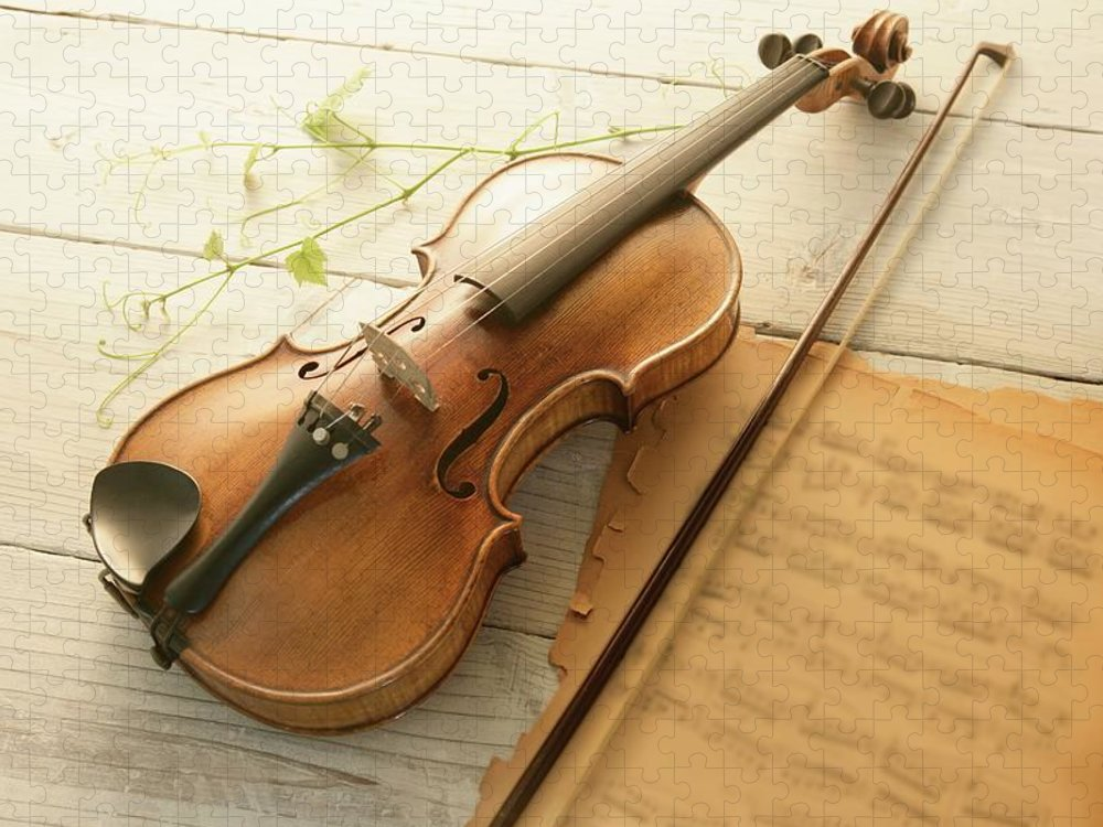 Sheet Music Puzzle featuring the photograph Violin And Music Sheet by Image Work/amanaimagesrf