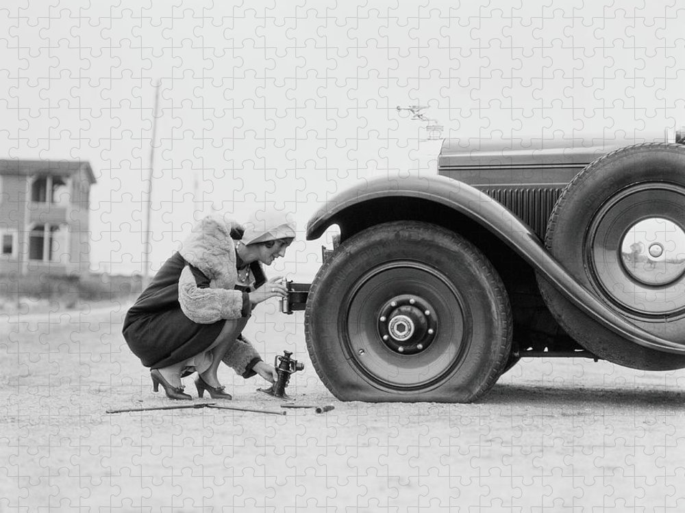 People Puzzle featuring the photograph Woman Changing Flat Tire On Car by H. Armstrong Roberts