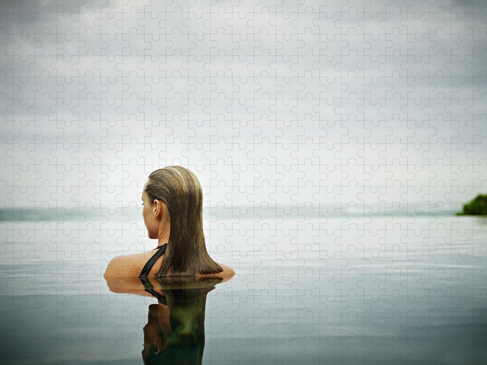 People Puzzle featuring the photograph Woman Standing In Infinity Pool by Thomas Barwick