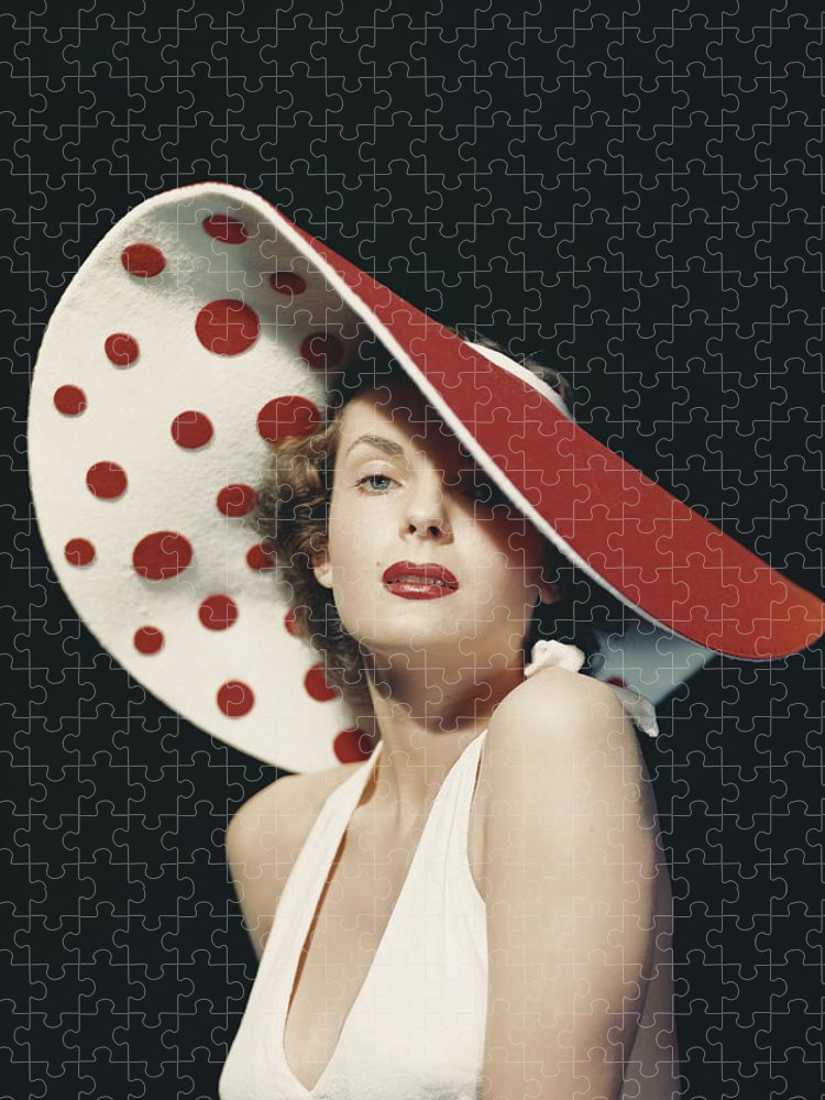 People Puzzle featuring the photograph Woman Wearing Large Spotted Hat by Tom Kelley Archive