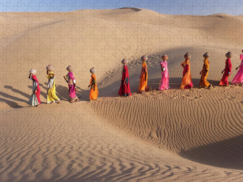 People Puzzle featuring the photograph Women Fetching Water From The Sparse by Mint Images - Art Wolfe