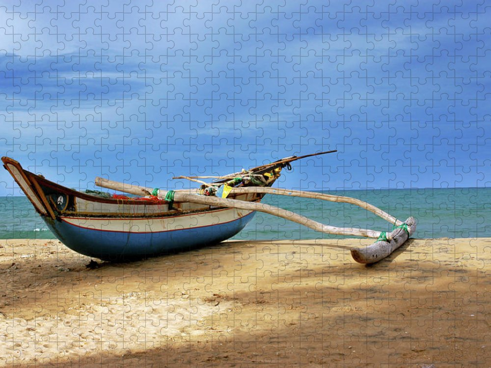 Tranquility Puzzle featuring the photograph Wooden Catamaran By The Sea Shore by Juavenita Alphonsus