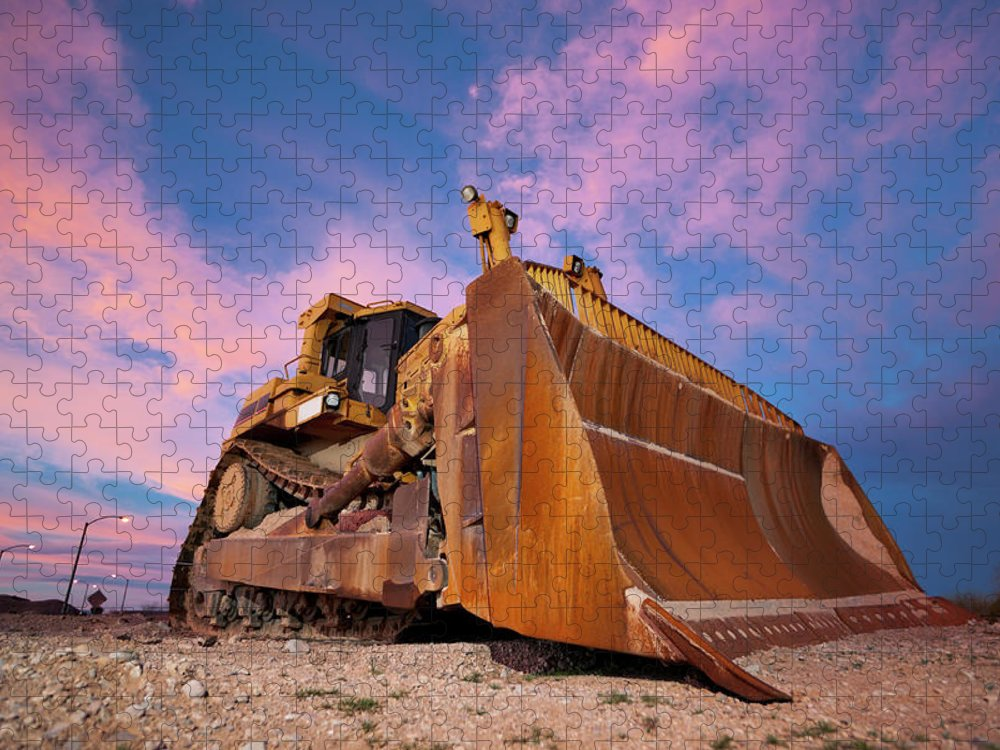 Toughness Puzzle featuring the photograph Yellow Bulldozer Working At Sunset by Wesvandinter