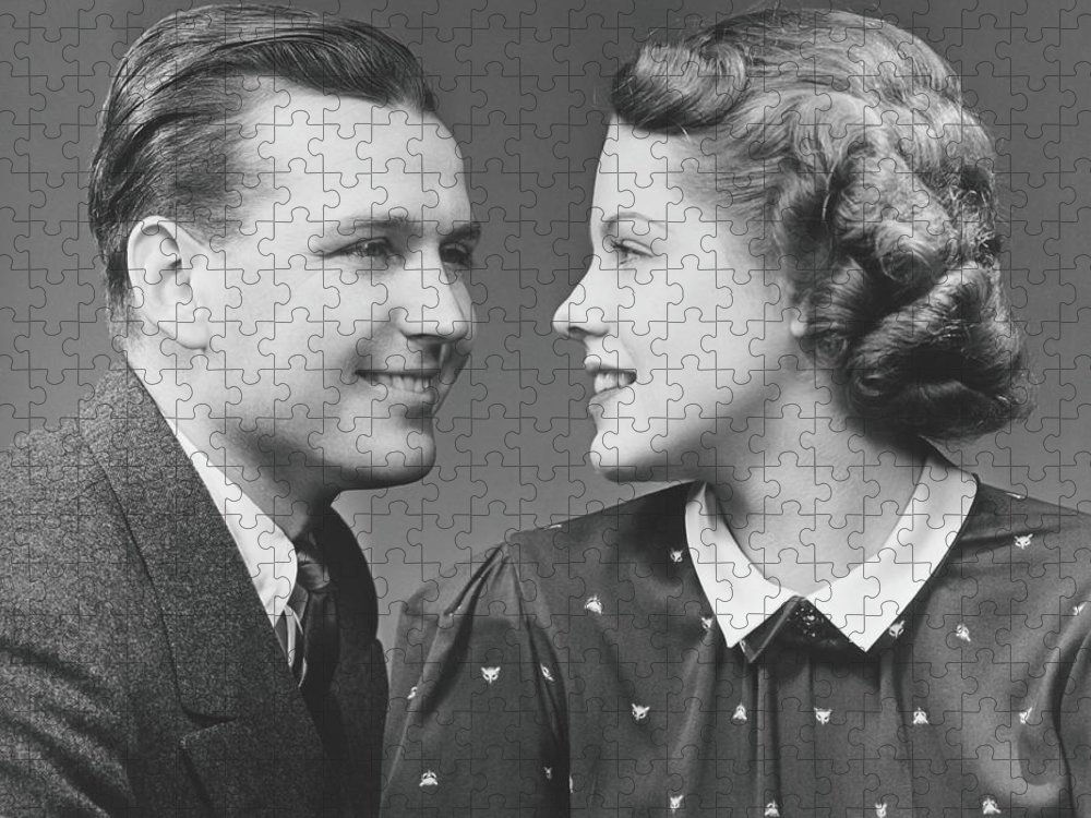 Young Men Puzzle featuring the photograph Young Couple Looking In Eyes In Studio by George Marks