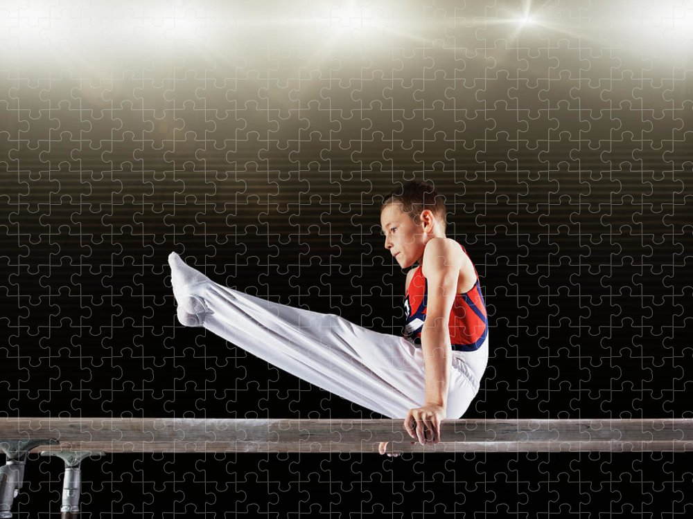 Focus Puzzle featuring the photograph Young Male Gymnast Performing On by Robert Decelis Ltd