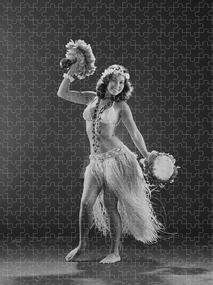 People Puzzle featuring the photograph Young Woman Hula Dancer With Feathered by Tom Kelley Archive