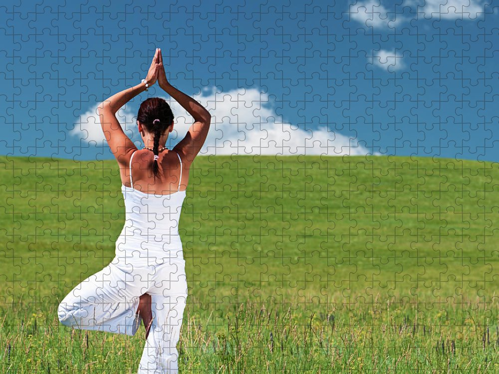 Scenics Puzzle featuring the photograph Young Woman Practicing Yoga by Hadynyah