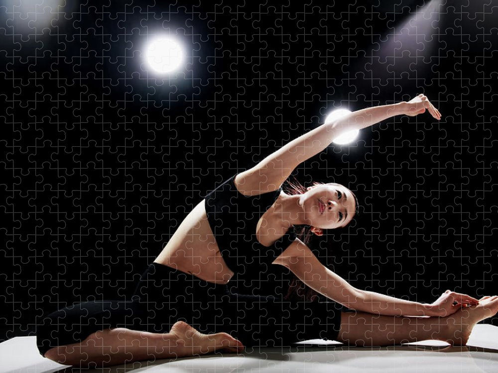 People Puzzle featuring the photograph Young Woman Stretching by Runphoto