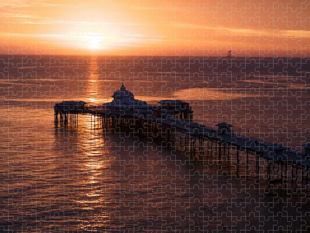Piers Puzzle featuring the photograph Sunrise over Llandudno pier 2 by Christopher Rowlands