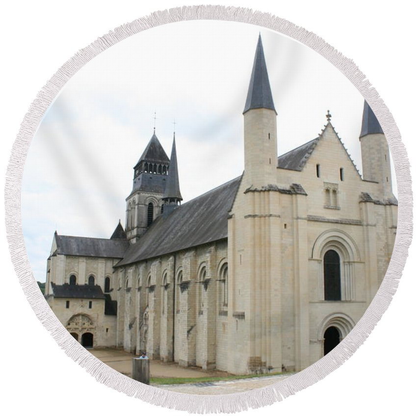 Cloister Round Beach Towel featuring the photograph West Facade Of The Church - Fontevraud Abbey by Christiane Schulze Art And Photography