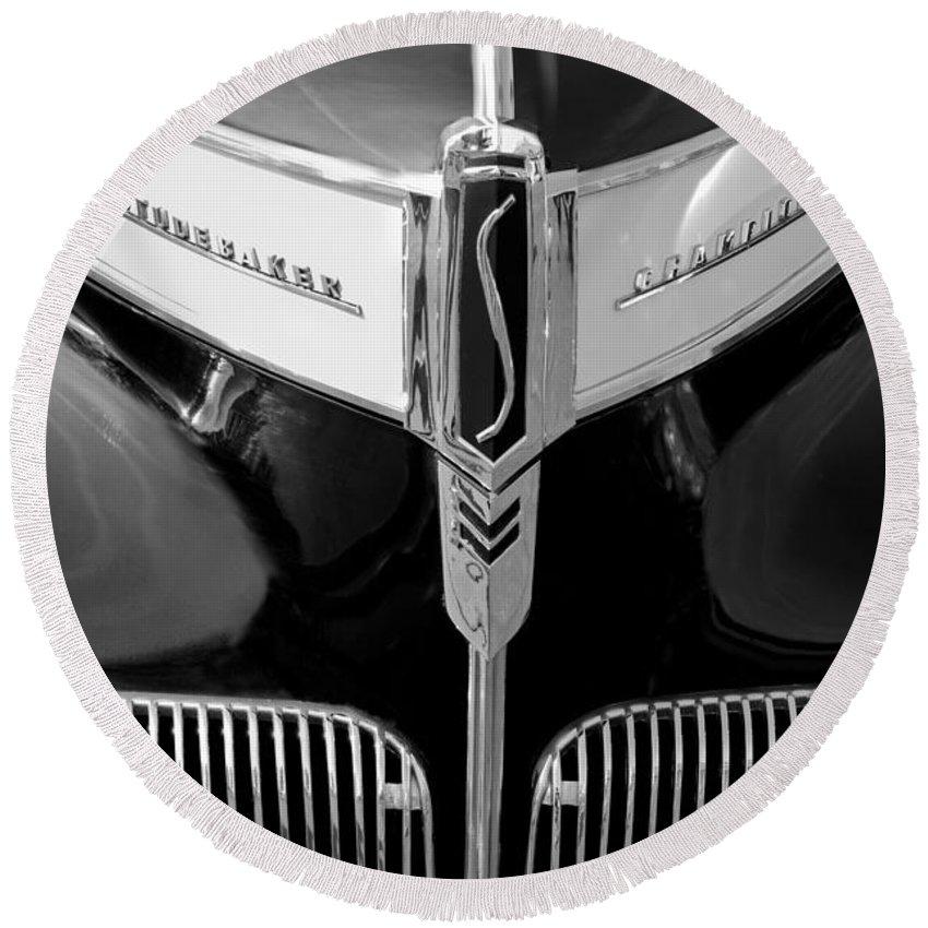 1941 Studebaker Champion Hood Emblem Round Beach Towel featuring the photograph 1941 Studebaker Champion Hood Emblem by Jill Reger