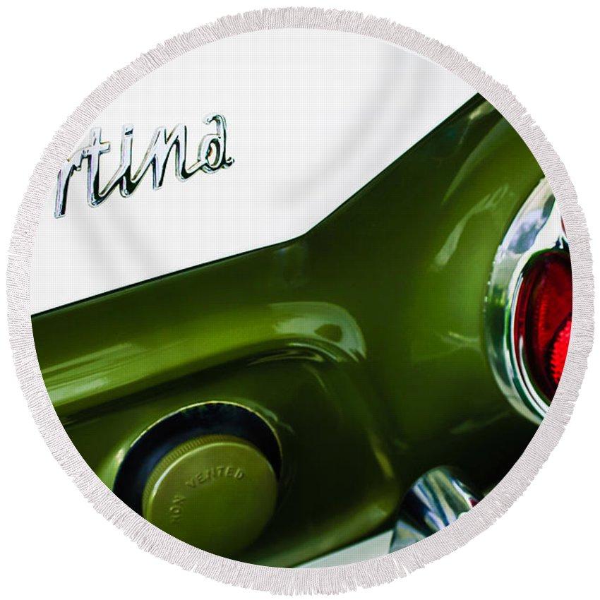 1966 Lotus Cortina Mk1 Taillight Emblem Round Beach Towel featuring the photograph 1966 Lotus Cortina Mk1 Taillight Emblem by Jill Reger